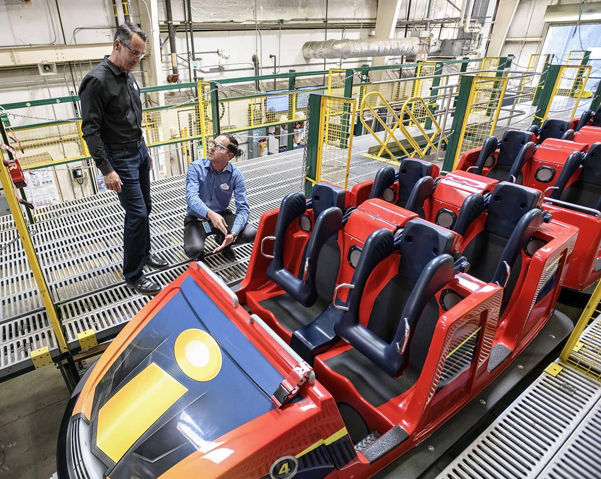 Trevor Larsen examining a rollercoaster